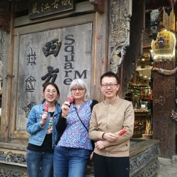 Mingyeng, Cathie and Qing relaxing in Lijiang after a hard day collecting Scutellaria spp